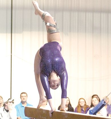 Staff photo by Steve Muscatello New Ulm's Emma Gauert competes on the beam during the Eagles' meet with Jackson County Central Thursday in New Ulm. For more photos of this event go to cu.nujournal.com