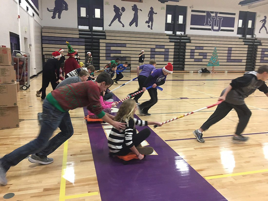"""Submitted photo New Ulm Middle School students celebrated the upcoming holiday break with Christmas House Games. Students competed with their """"house"""" mates in a variety of games and races."""