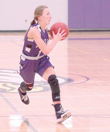 File photo by Steve Muscatello New Ulm's Joey Batt has been up to the task of replacing Meleah Reinhart's points from last year for the Eagles. Batt is averaging 30.3 points per game prior to Friday's game against Martin County West.