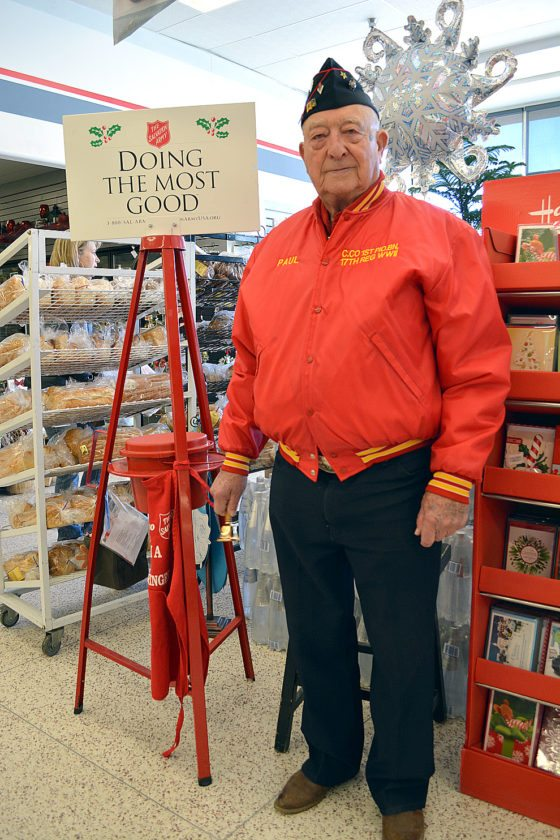 Staff photo by Connor Cummiskey Veteran Paul Wojahn, 96, volunteered to ring the bell for the Salvation Army kettle inside Hy-Vee Saturday.