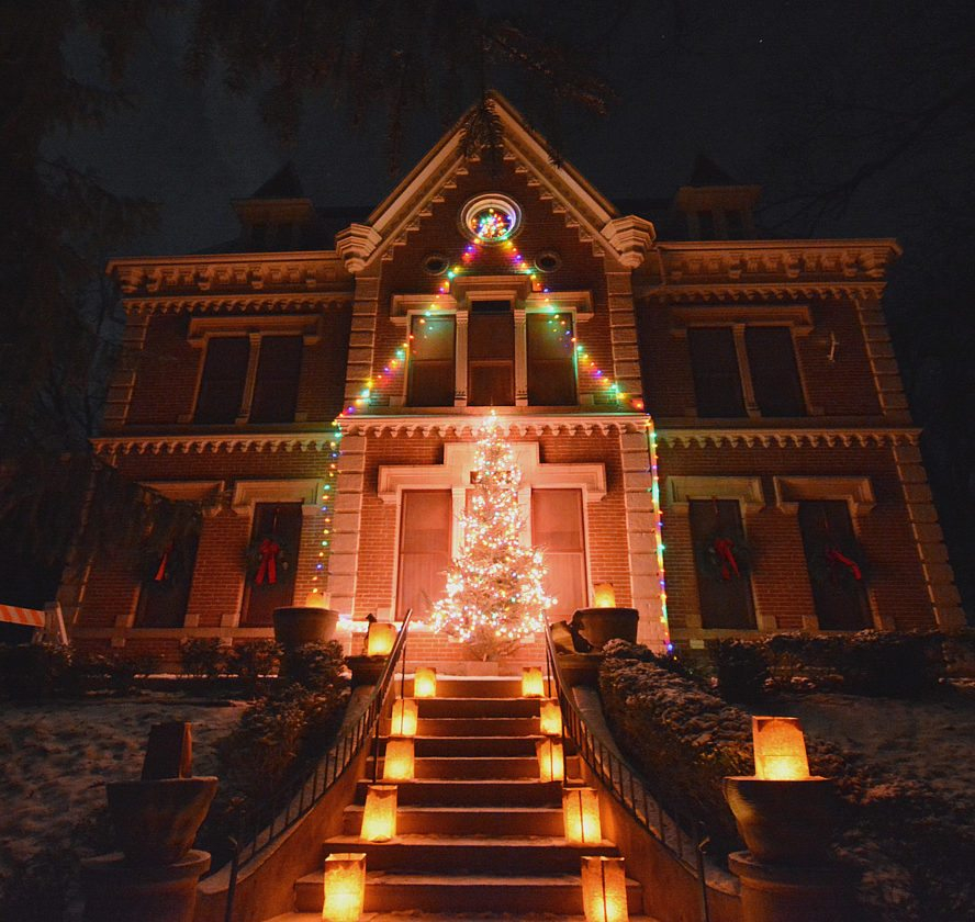Schell's Brewery lit up the gardens and Schell Mansion for Christmas Eve and Christmas Day with its Christmas Luminaria and a glowing Christmas tree on the porch of the mansion.