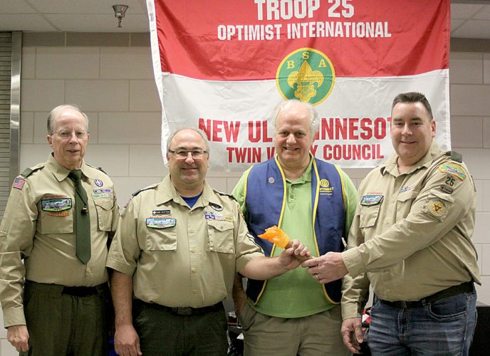 """On Dec. 17 Boy Scout Troop 25 in New Ulm had its annual awards ceremony.  Part of the night was devoted to a """"passing the torch"""" ceremony to install the new scoutmaster Dan Kotten and thank the outgoing scoutmaster Steve Gag. Pictured  left to right are Tom Henderson, troop committee chair; Dan Kotten, new scoutmaster; Terry Sveine, representing the troop sponsor New Ulm Optimist Club, and Steve Gag, outgoing scoutmaster."""