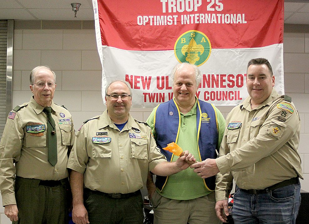 "On Dec. 17 Boy Scout Troop 25 in New Ulm had its annual awards ceremony.  Part of the night was devoted to a ""passing the torch"" ceremony to install the new scoutmaster Dan Kotten and thank the outgoing scoutmaster Steve Gag. Pictured  left to right are Tom Henderson, troop committee chair; Dan Kotten, new scoutmaster; Terry Sveine, representing the troop sponsor New Ulm Optimist Club, and Steve Gag, outgoing scoutmaster."