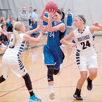 Staff photo by Steve Muscatello Nicollet's Brooke Skrien tries to get between Chloe Ufkes and Alyssa Petersen (24) of Buffalo Lake-Hector-Sewart Thursday in Nicollet. For more photos of this event go to cu.nujournal.com