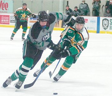 Staff photo by Steve Muscatello New Ulm Steel forward Brandon Mehlhop gets past a Breezy Point North Stars defender during the first period Friday at the New Ulm Civic Center. For more photos of this event go to cu.nujournal.com