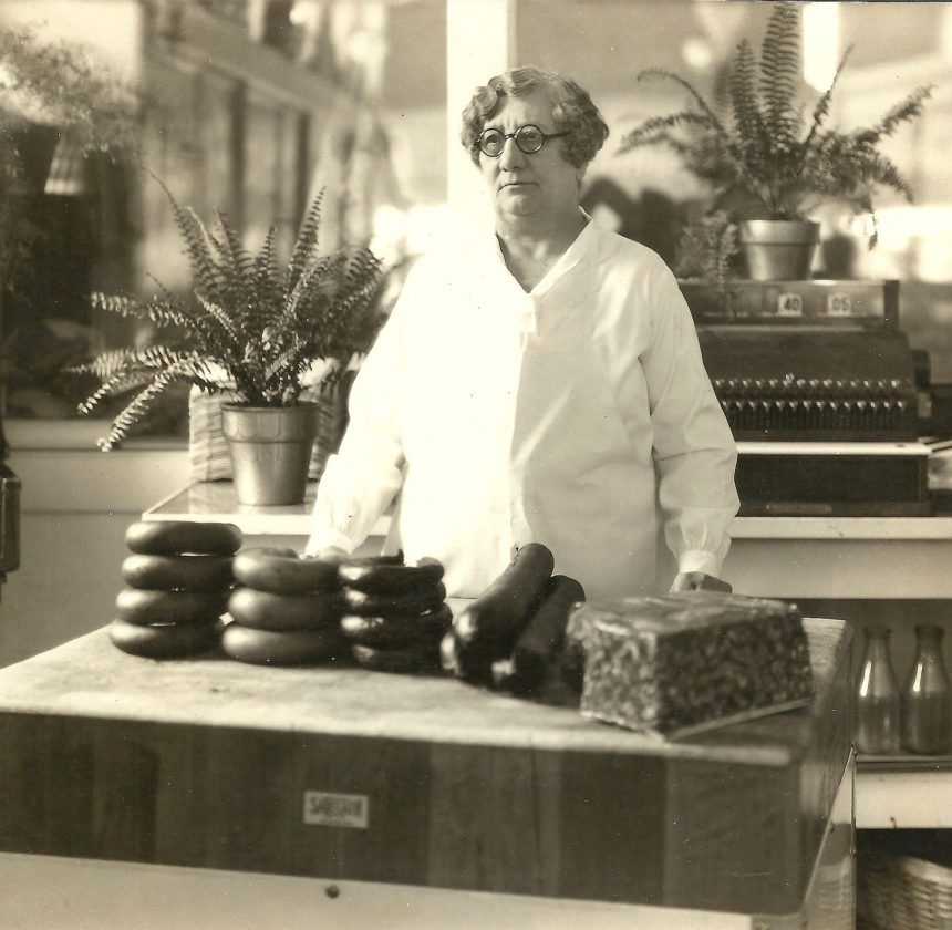 Rosa Schnobrich, one of New Ulm's earliest businesswomen, stands behind her the counter of City Meat Market. (Photo courtesy of Brown County Historical Society Museum)