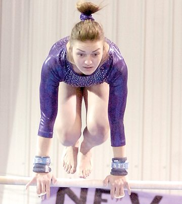 Staff photo by Steve Muscatello New Ulm senior Sarah Longtin competes on the bars during the Eagles meet with St. Peter Thursday in New Ulm. For more photos of this event go to cu.nujournal.com