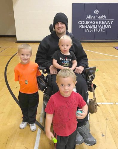 "Submitted photo Delsin ""Dee"" Zamzow enjoyed a visit from sons Ryker, left: Dalton, front, and Zeke at Allina's Courage Kenny Rehabilitation Institute Center in Golden Valley. Zamzow wasparalyzed in a dirt bike accident May 31, 2017. The Lafayette Lions Club is holding a benefit next week to raise funds to make his home handicapped accessible, so he can return home"