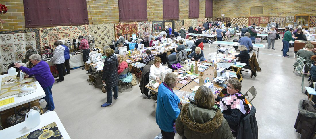 A roomful of quilters worked on their projects in the St. George Parish Center on Saturday during the Sewing for Sight quilt fundraiser.