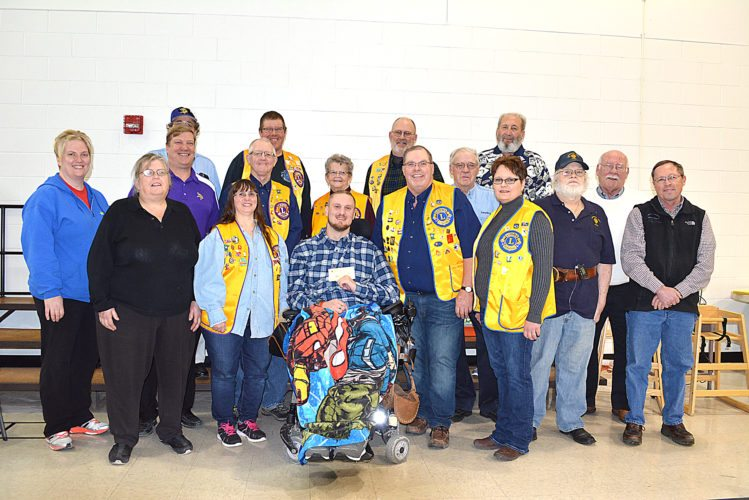 Staff photo by Connor Cummiskey  The Lafayette Lions Club presented Delsin Zamzow (center) with a $1,000 check to help renovate his home after a serious dirt-biking accident severely limited his mobility.
