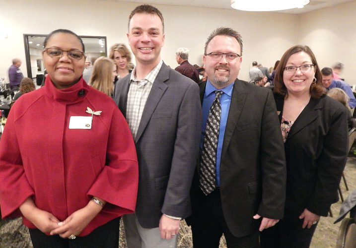 Staff photo by Fritz Busch New Ulm Area Chamber of Commerce Directors who were honored at the annual meeting Jan. 19 include, from left, Heather Braimbridge-Cox, of Windings; 2017-18 Board chairman Mike Wise, Thriveon; Brian Shropshire, Citizens Bank, and Chamber CEO Audra Shaneman. Not pictured, Eric Bode, BoCo Real Estate and Candas Schouvieller, Oak Hills Living Center.