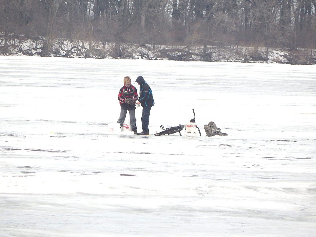 Staff photo by Fritz Busch  Two boys try their luck ice fishing on Sleepy Eye Lake Jan. 21. A large number of fish houses are on the lake. The 37th Annual Sportsmen's Club Ice Fishing Derby on Sleepy Eye Lake is noon to 3 p.m. Feb. 4.