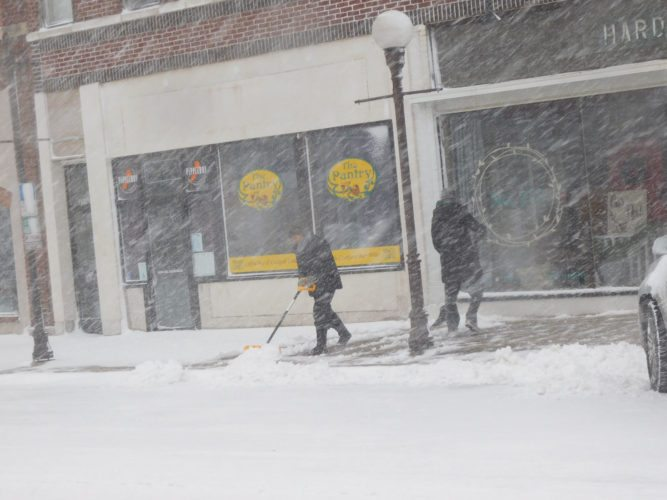 Downtown business owners did their best to keep the sidewalks clear, but as the snow failed to let up, many found shoveling to be sisyphean task.