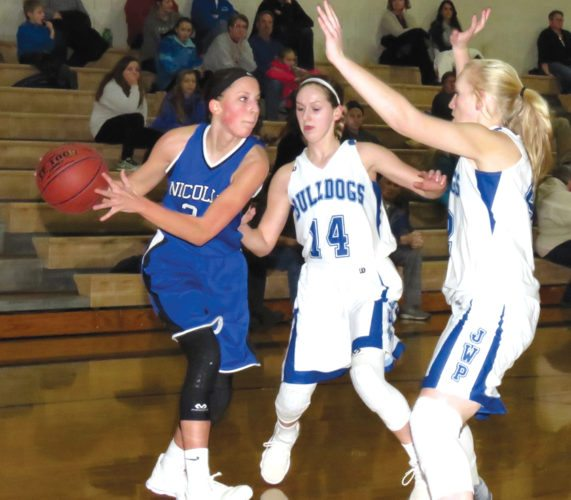Photos courtesy of Ruth Klossner Brooke Skrien attracts a double team when attempting to make a pass in a recent game in Nicollet against Janesville-Waldorf-Pemberton.