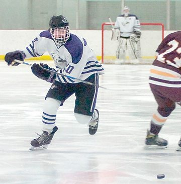 File photo by Steve Muscatello New Ulm's Kyle Tauer races toward a loose puck during a recent game a the New Ulm Civic Center.