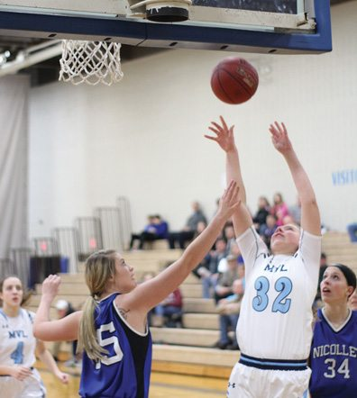 Staff photo by Travis Rosenau MVL's Lauren Paulsen goes up for a shot against Lindsey Boerger (45) of Nicollet in Monday's game between the Raiders and Chargers at Nicollet as Brooke Skrien (34) and Haley Birkholz (4) look on.