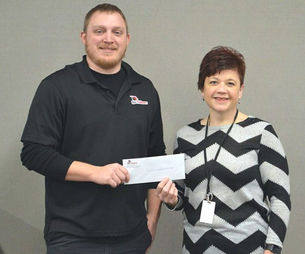 NU-Telecom employees recently held an internal fundraiser to support fellow employee, Becki Herzog, as she participates in The Leukemia and Lymphoma Society Big Climb Minneapolis in February. Pictured are NU-Telecom's Nick Asmus presenting Becki with the donation of $385.