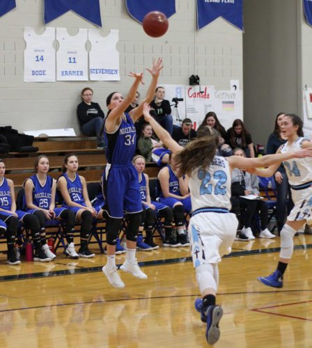 File photo by Travis Rosenau Brooke Skrien (34) pulls up for a jumper against MVL in a home game on Jan. 29. Skrien passed 1,000 points on Tuesday against Granada-Huntley-East Chain/Truman/Martin Luther.