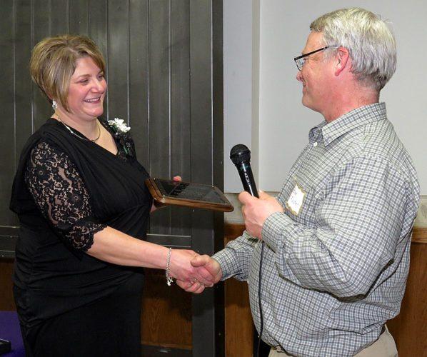 Hub Club president Brian Fischer presented the Service to Ag plague to newest recipient Michele Schroeder.