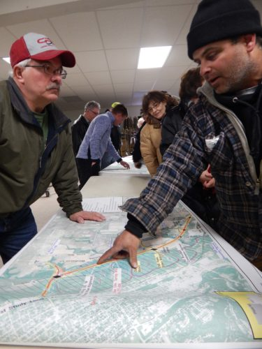 Staff photo by Fritz Busch  Tim Kohn, Courtland, left, and Shane Kraus, New Ulm, right, were among attendees at the Highway 14 New Ulm to Nicollet Task Force open house at the Courtland Community Center Feb. 1. The task force is charged with providing recommendations to the Minnesota Department of Transportation (MnDOT) District 7 that make the best use of potential transportation funding.