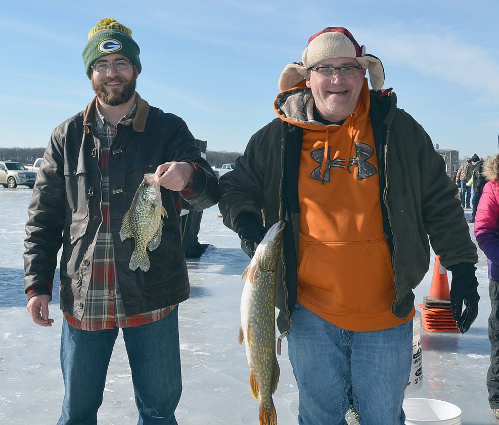 """Staff photo by Connor Cummiskey During the 2017 Sleepy Eye Ice Fishing Derby, Luke Wunderlin and Dave Wirth both caught impressive fish. Wunderlin caught a .742, 11"""" crappie and Dave Wirth caught a 4.31 lb northern"""