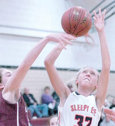 Staff photo by Steve Muscatello New Ulm Cathedral's Becca Schwarz (left) tries to block a shot from Sleepy Eye's Maya Ibberson (32) during the second half Monday at CHS. For more photos of this event go to cu.nujournal.com