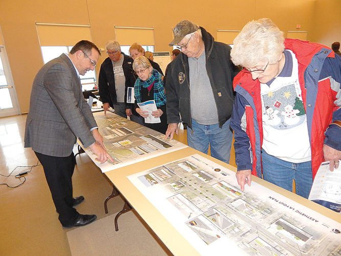 Staff photo by Fritz Busch  A large group of people attend a New Ulm Gateway (Highway 14/15) construction open house at the New Ulm Community Center Feb. 8. Construction work on 7th North including the bridge over the street and 7th North from Broadway to the Highway 14/15 intersection is set to begin in April and continue through October. A detour route follows Highway 14 to 20th Street South.