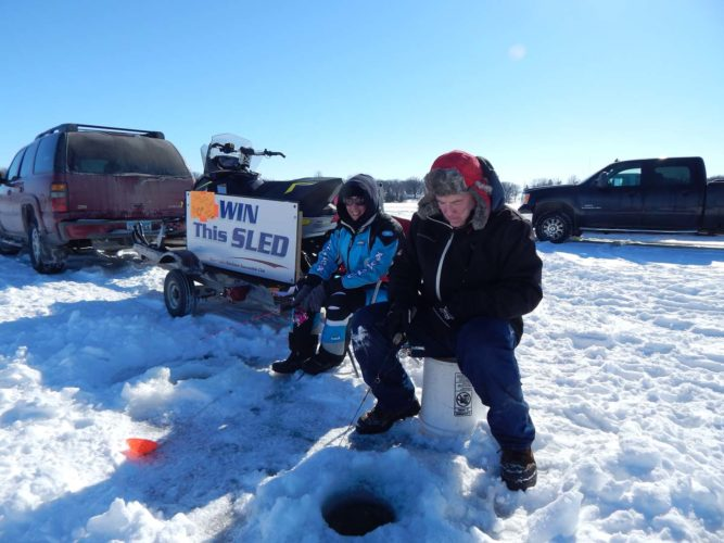 Staff photo by Fritz Busch  Tim and Candice Stadick of New Ulm participate in the New Ulm Area Sport Fishermen 31st Annual Ice Fishing Contest at Clear Lake Feb. 11. Tournament officials said more than 1,100 people were on the ice.