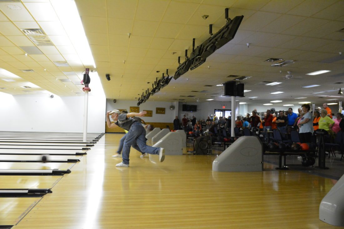Staff photo by Connor Cummiskey  A crowd looks on as bowlers take their turns at the lanes during the 15th annual Bowling Classic Fundraiser hosted by the Oak Hills Memorial Foundation Monday at Concordia Lanes.