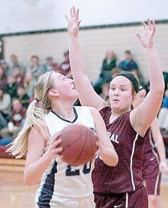 Staff photo by Steve Muscatello New Ulm Cathedral's Shay Ubl guards Lexi Toll of Cedar Mountain/Comfrey as she looks to the basket during the first half Tuesday at CHS. For more photos of this event go to cu.nujournal.com