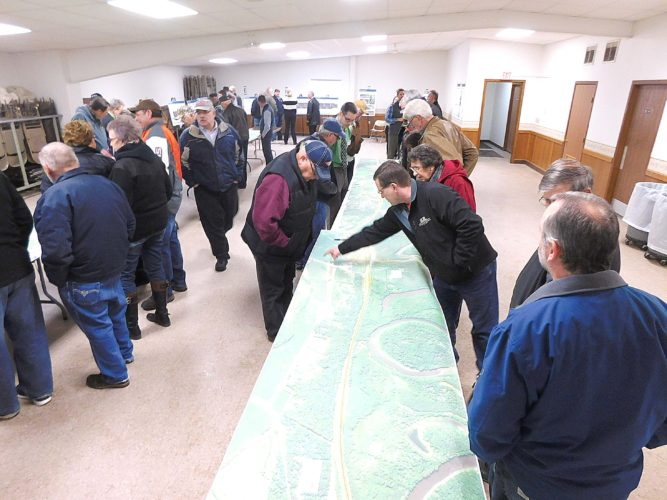Staff photo by Clay Schuldt  Over a hundred people visited the Courtland Community Center to review detailed maps of the proposed Highway 14 expansion Thursday.