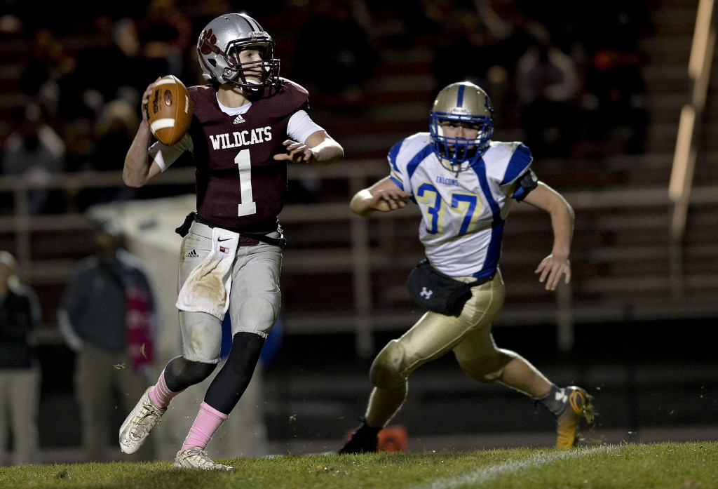 Warren County quarterback Robert Rutherford looks to pass as Central's Marshall McAboy pursues during first half football action Oct. 24 in Front Royal.  Rich Cooley/Daily file
