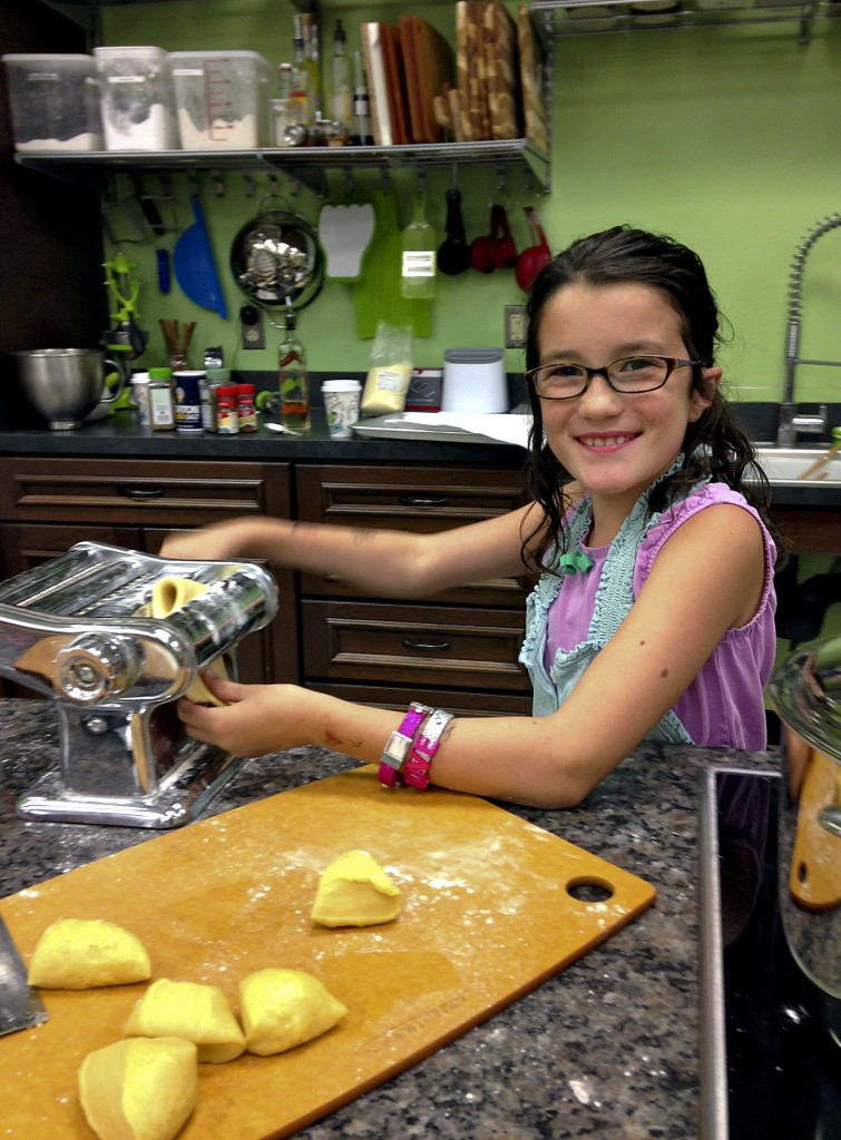 "Abby Major, 9, makes pasta at her Winchester home. Abby was a contestant on the Fox TV show ""MasterChef Junior."" Photo courtesy of Maggie Major."