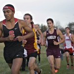 Jahlil Northover leads a line of runners up this hill during Thursday's Region 4A North Cross Country meet at Kernstown Battlefield.   Rich Cooley/Daily