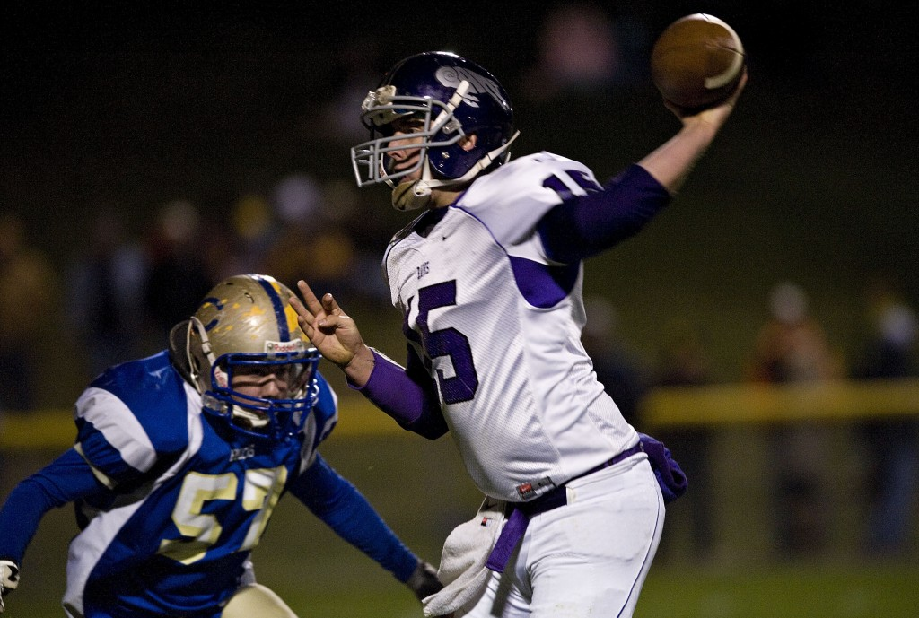 Strasburg's Mark Smoot throws a pass while Central's Matthew Edwards prepares to tackle him during second quarter action Friday night in Woodstock. Rich Cooley/Daily