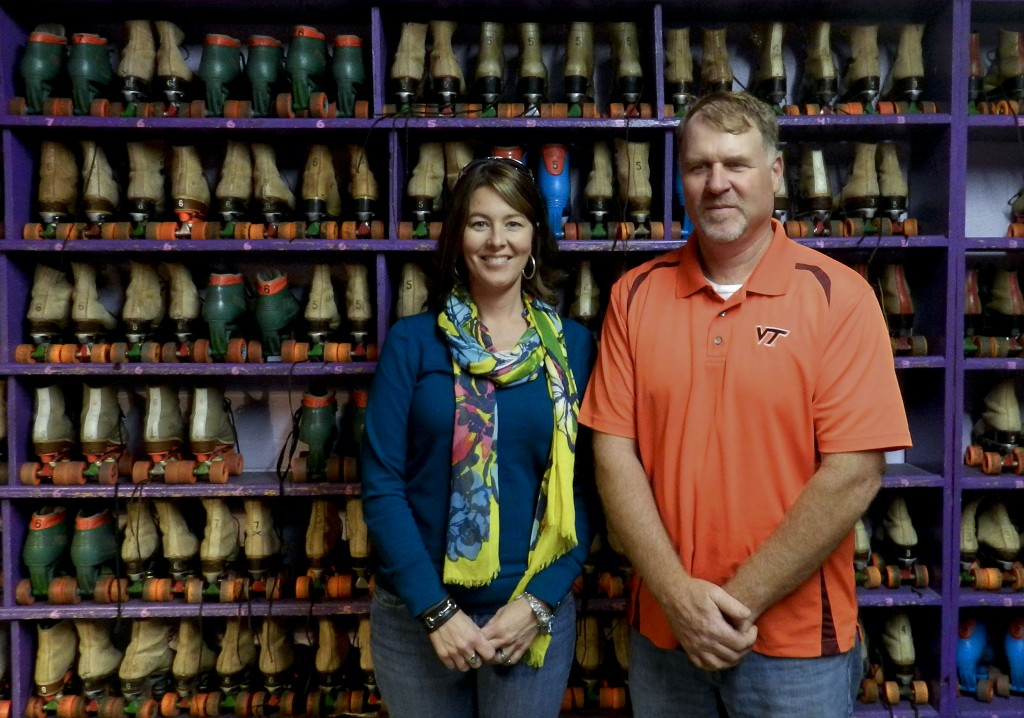 Christi and Raymond Heflin stand in front of the roller skates for Mac's Roller Rink. Henry Cuvlyhouse/Daily