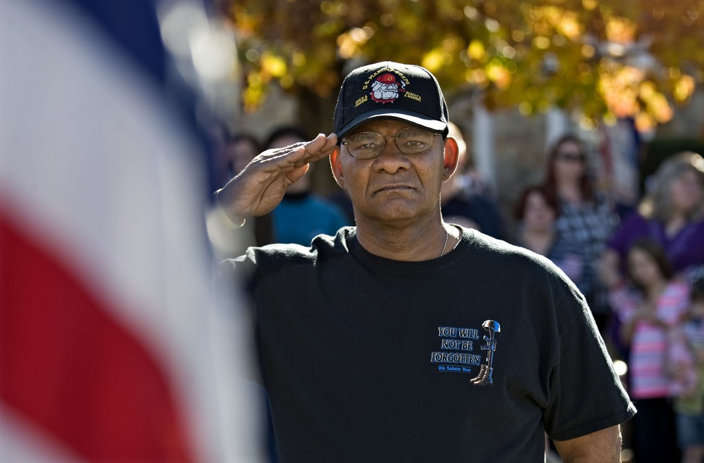 U.S. Marine veteran Bob Moore, 61, salutes during the playing of the national anthem outside the Warren County Circuit Courthouse on Tuesday morning during the Veterans Day ceremony. Rich Cooley/Daily