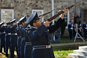 Hong XI Wang, 17, a member of the Randolph-Macon Academy Honor Guard Unit, fires a 21-gun salute during the close of the Veterans Day program at Warren County Circuit Courthouse on Tuesday morning.  Rich Cooley/Daily