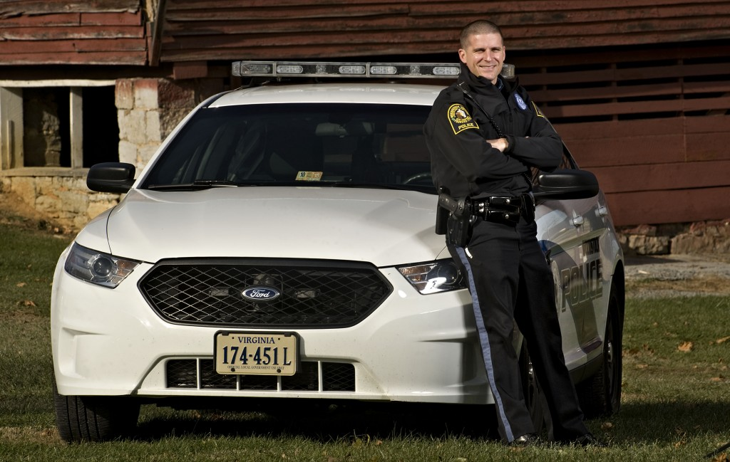 Woodstock police officer Stuart Leake shows off one of the department's new winter coats.   Rich Cooley/Daily