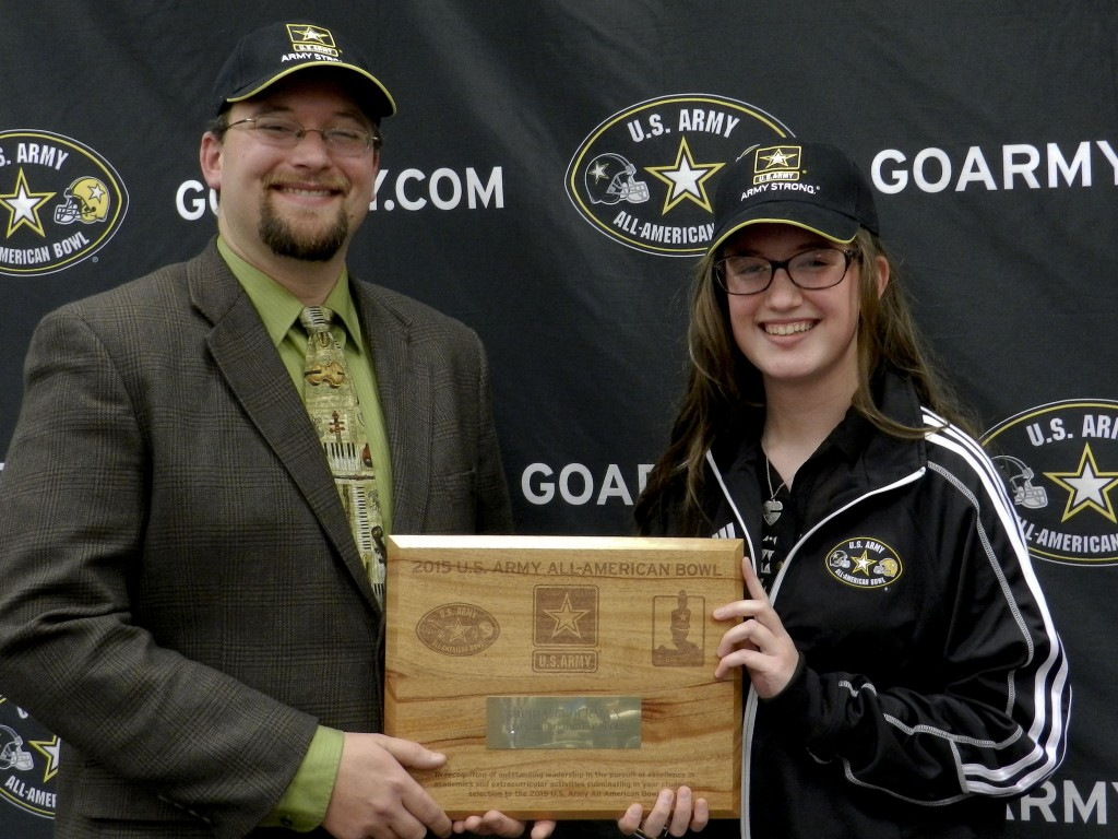 Strasburg High School senior Sophia Lederman, right, poses with high school band director, Chris Szuba, at her school on Thursday. Lederman was named a member of the U.S. Army All-American Marching Band, which will perform at the All-American Bowl on Jan. 3 in San Antonio, Texas.  Josette Keelor/Daily