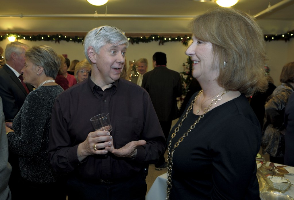 Dr. Gregory S. Byrd, past board president, and Pat Koch, current board president of the Shenandoah Community Health Clinic, chat during the annual Holiday Sparkle Gala and Auction to benefit the Shenandoah Community Health Clinic. The event was held last month at the historic Edinburg Mill in Edinburg. Courtesy photo