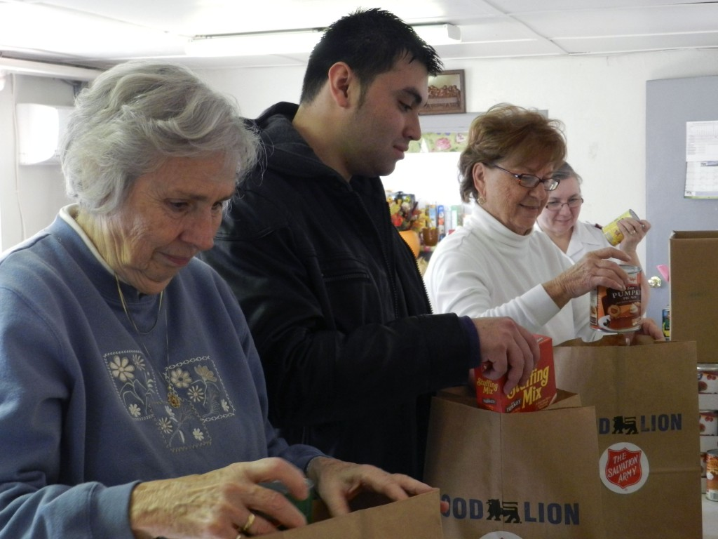 Salvation Army of Front Royal volunteers, from left, Ann Crum, William Danh, Eleanor Chadwell and Capt. Beth Forrer pack bags on Monday morning for Thanksgiving meal deliveries they were planning on making on Tuesday. The Salvation Army also plans to host a community Thanksgiving dinner from 4:30 to 6:30 p.m. Thursday. Josette Keelor/Daily