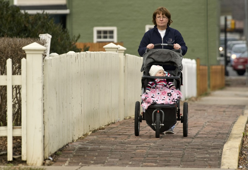 Melinda Wilson takes her 14-month old granddaughter, Kendall Wilson, on a stroll along this section of Massanutten Street in Strasburg recently. Rich Cooley/Daily
