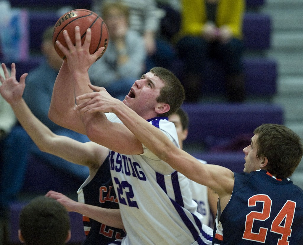 Strasburg's Ryan Smoot is fouled by Clarke County's Colton Chrane as he goes up under the basket during last season's game in January. Rich Cooley/Daily file