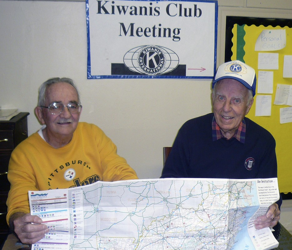 Phil Loving, left, and Doug Butler, members of the Kiwanis Club of Strasburg, look over a map of Shenandoah County to determine the highway location of an Adopt-A-Highway request to the Virginia Department of Transportation for the club's community service pick up project. Courtesy photo