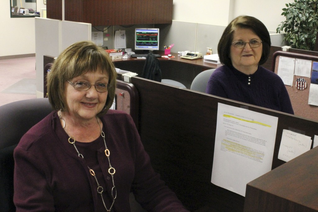 Linda Cave and Sharon Kibler sit at their desks in the Shenandoah County Treasurer's Office on Monday. Cave and Kibler plan to retire in July. Alex Bridges/Daily