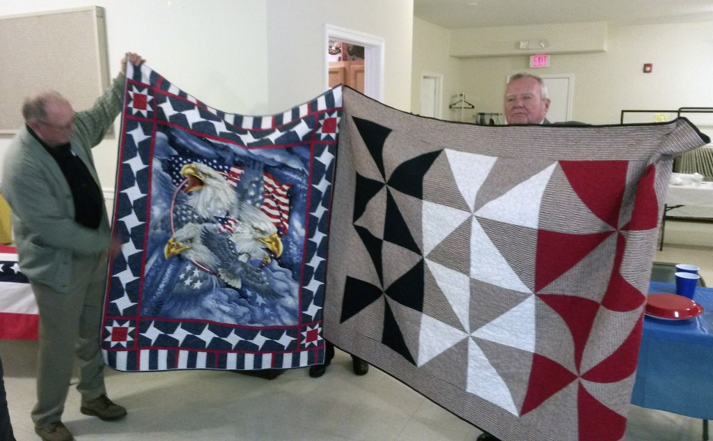 the Skyline Quilters Guild celebrated a veterans event with the Strasburg American Legion Post 77 Honor Guard. Here, David and Stewart Smith show their new quilts. Twelve Post 77 members received new quilts.  Courtesy photo