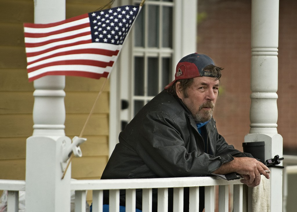 Jim Allenson, of Middletown, watches traffic pass outside his home along Main Street on a recent afternoon. Rich Cooley/Daily