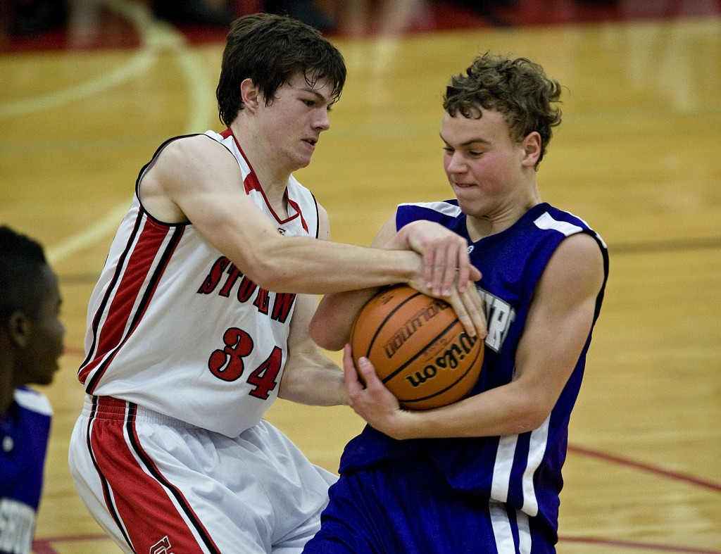 Stonewall Jackson's Kory Somers, left, wrestles for the ball with Strasburg's Tyler Fincham on Dec,  5 in Quicksburg. Somers is averaging over 11 points per game this season for the Generals.  Rich Cooley/Daily file