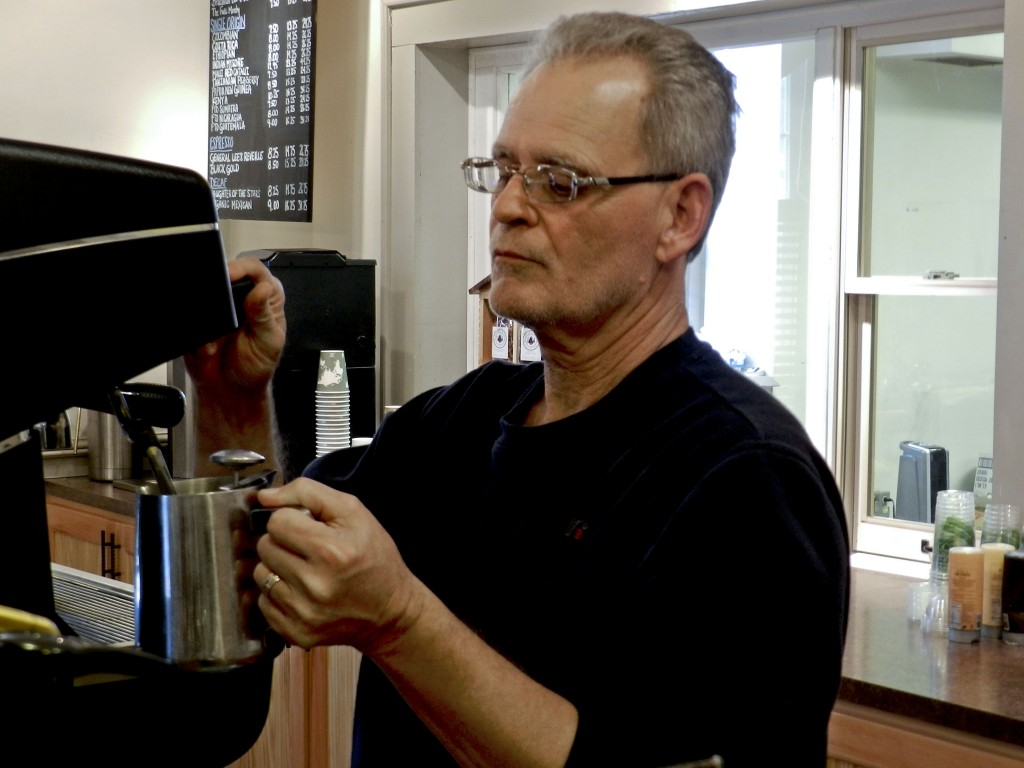 Monty Ruckman, owner of Jackson's Corner Cafe, whips up an eggnog latte.  Photo by Henry Culvyhouse